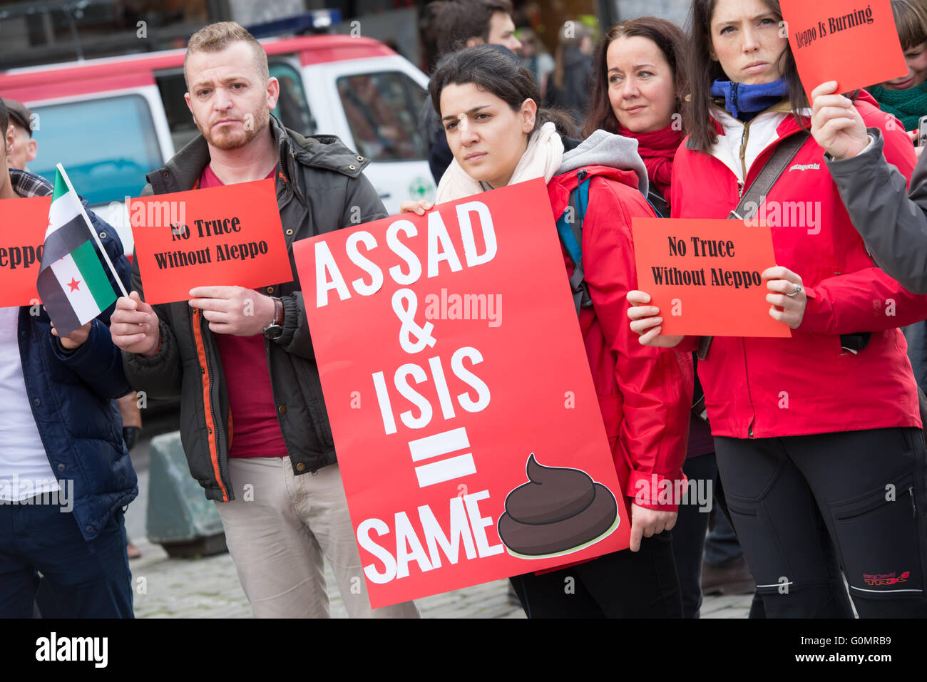 Syrian refugees protest President Bashar al-Assad during the May Day parade in Oslo, Norway, May 1, 2016. - Stock Image