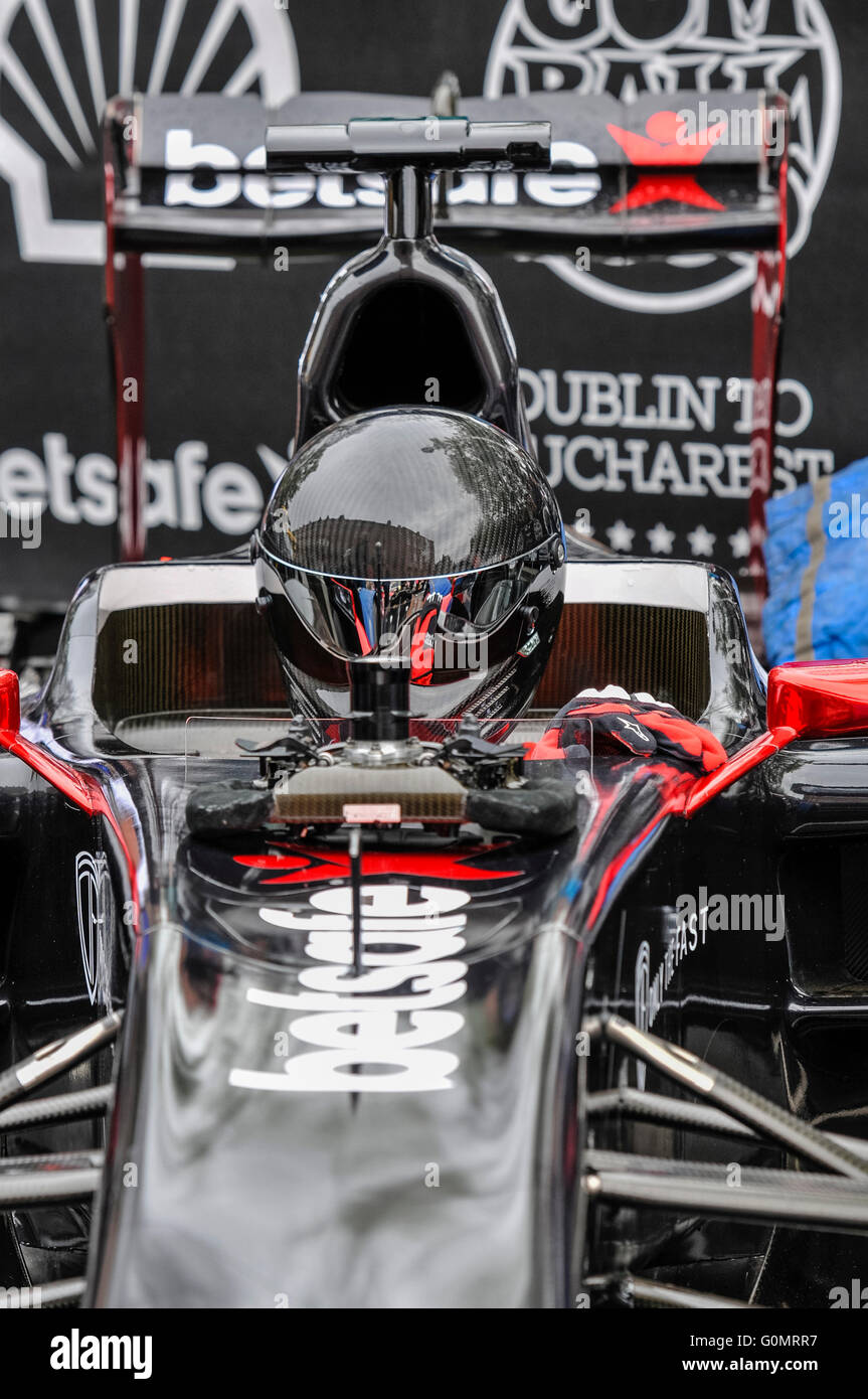 DUBLIN, IRELAND. MAY 01 2016 - The  Driver for the Formula 1 team gets ready in his seat, before attaching his multi - Stock Image