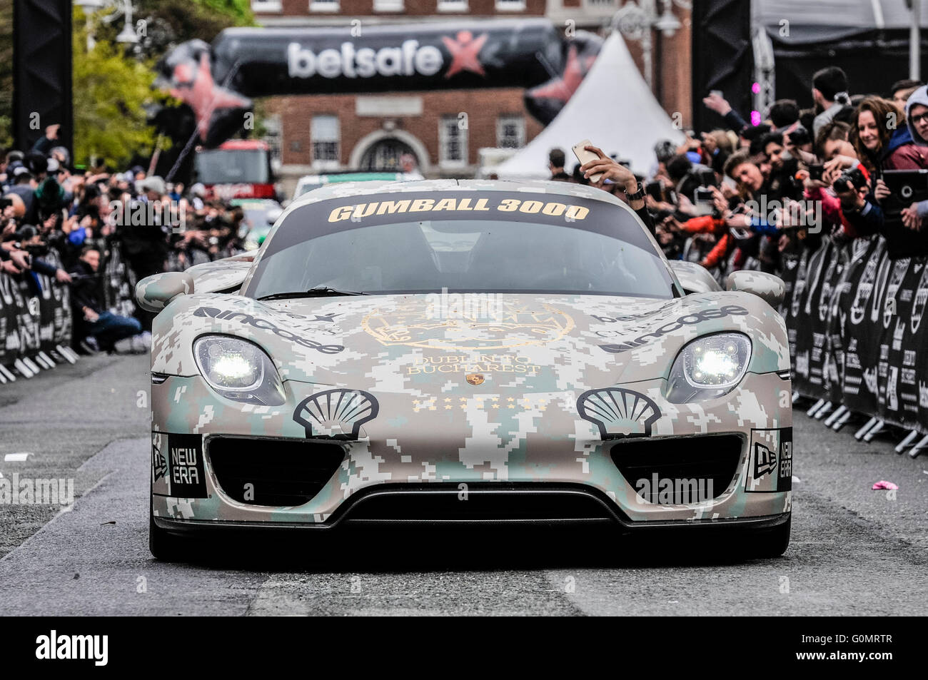 Porsche 918 Spyder plug-in hybrid hypercar with camouflage vinyl wrap at the starting line of the Gumball 3000 from - Stock Image