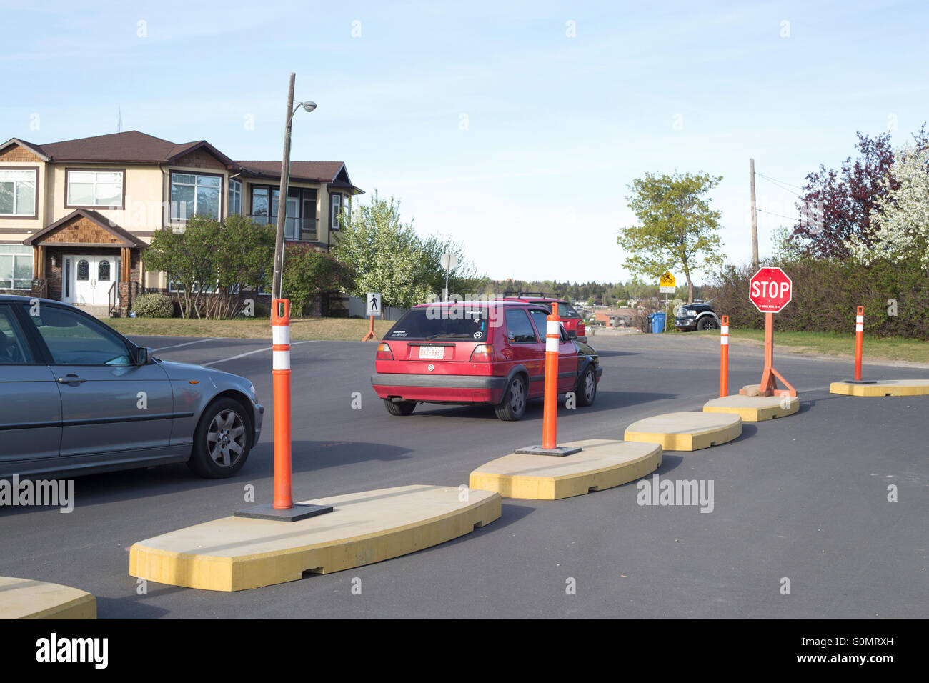 Traffic calming curbs in city street - Stock Image