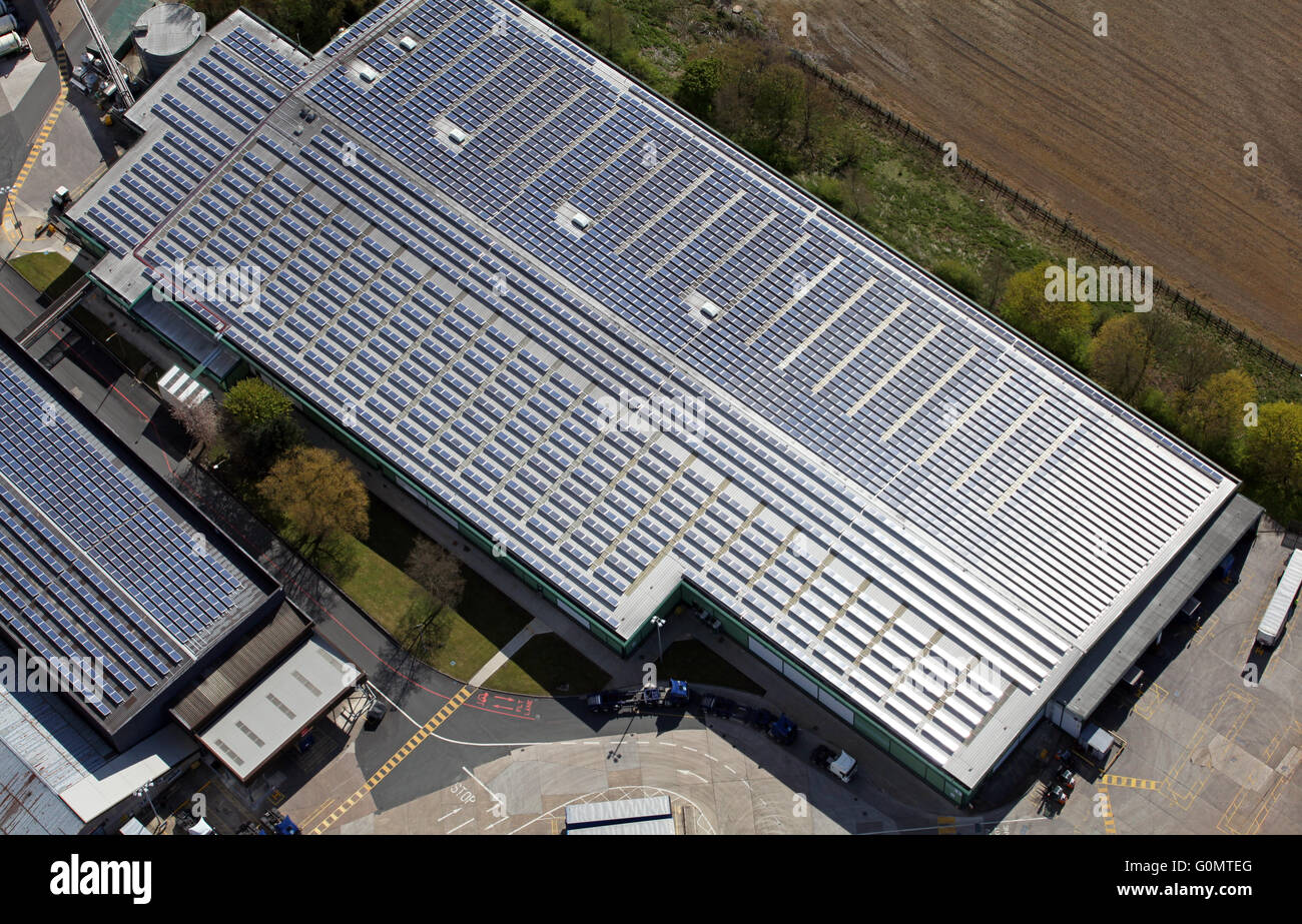 aerial view of solar panels on a factory roof, north of England, UK - Stock Image