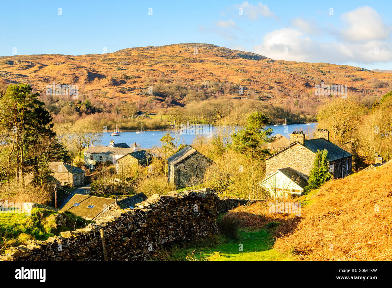 The hamlet of Nibthwaite beside Coniston Water. Swallows and Amazons author Arthur Ransome spent many childhood - Stock Image