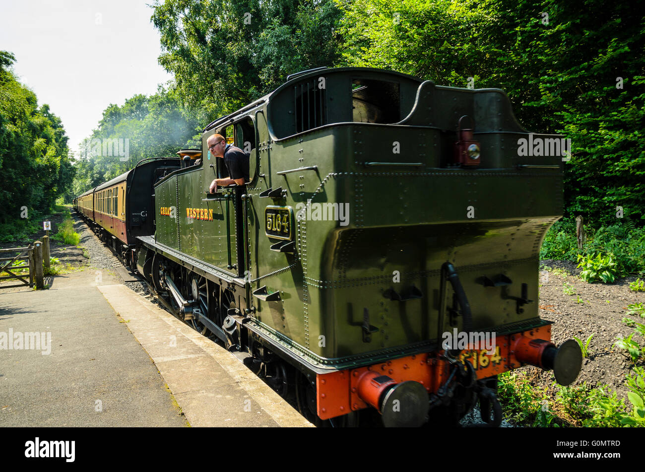 Ex-Great Western Railway tank engine No. 5164 hauls a train on the Severn Valley Railway in Shropshire England - Stock Image