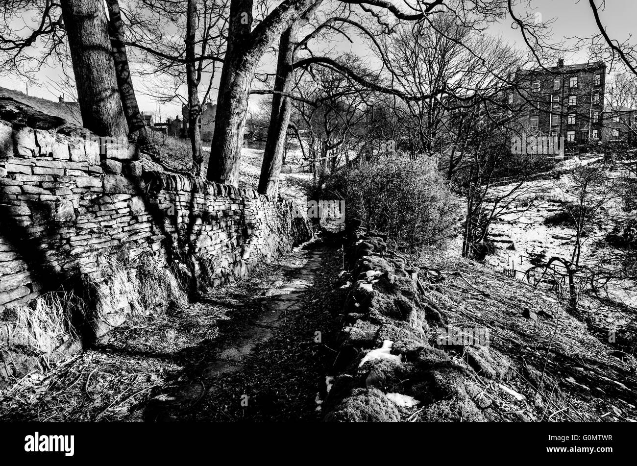 Monochrome image of Old bridleway at Pecket Well near Hebden Bridge in Calderdale West Yorkshire - Stock Image
