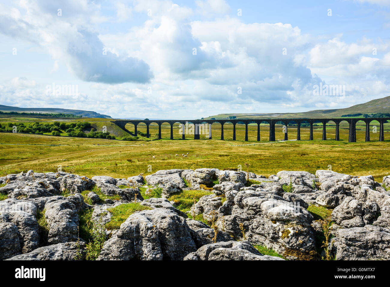 Limestone outcrops and Ribblehead Viaduct in the Yorkshire Dales - Stock Image