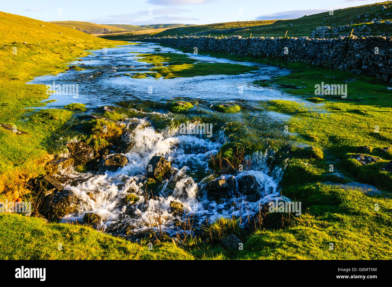 Stream disappears underground at Water Sinks near Malham Tarn on the Pennine Way in the Yorkshire Dales National - Stock Image