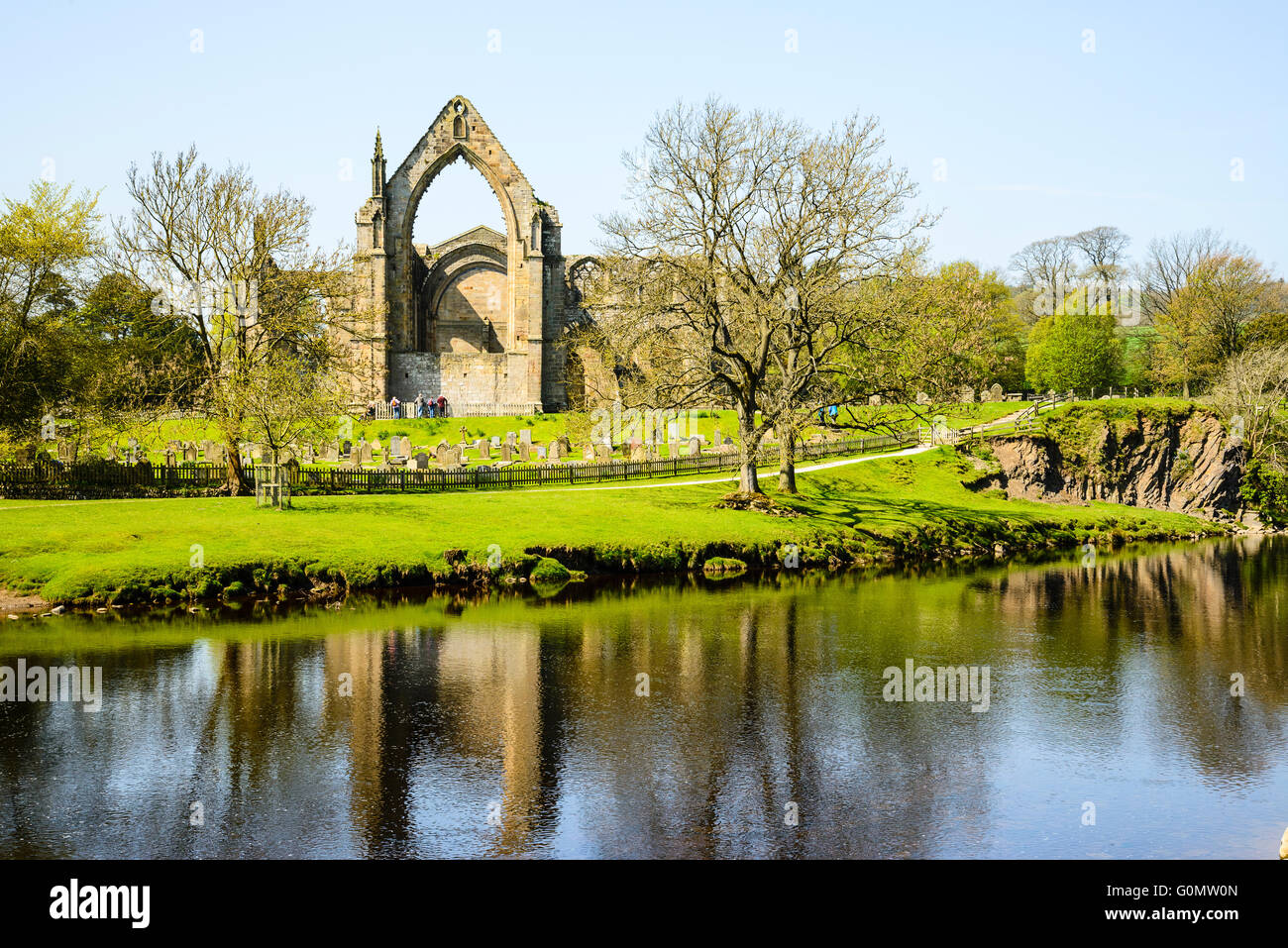 Looking across the River Wharfe to the ruins of Bolton Abbey, North Yorkshire - Stock Image