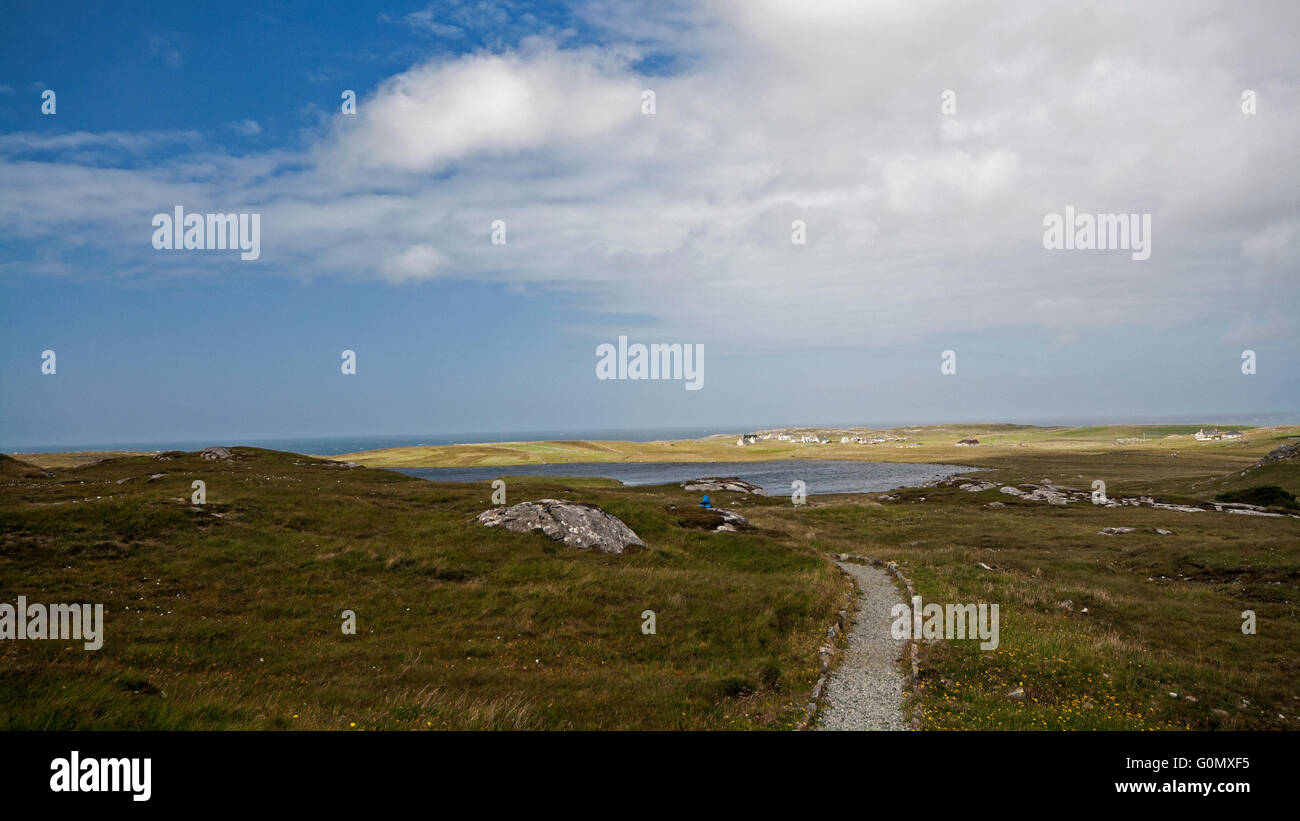 Crossing the moor to the restored Norse mill and kiln at Shawbost, Isle of Lewis, Scotland - Stock Image