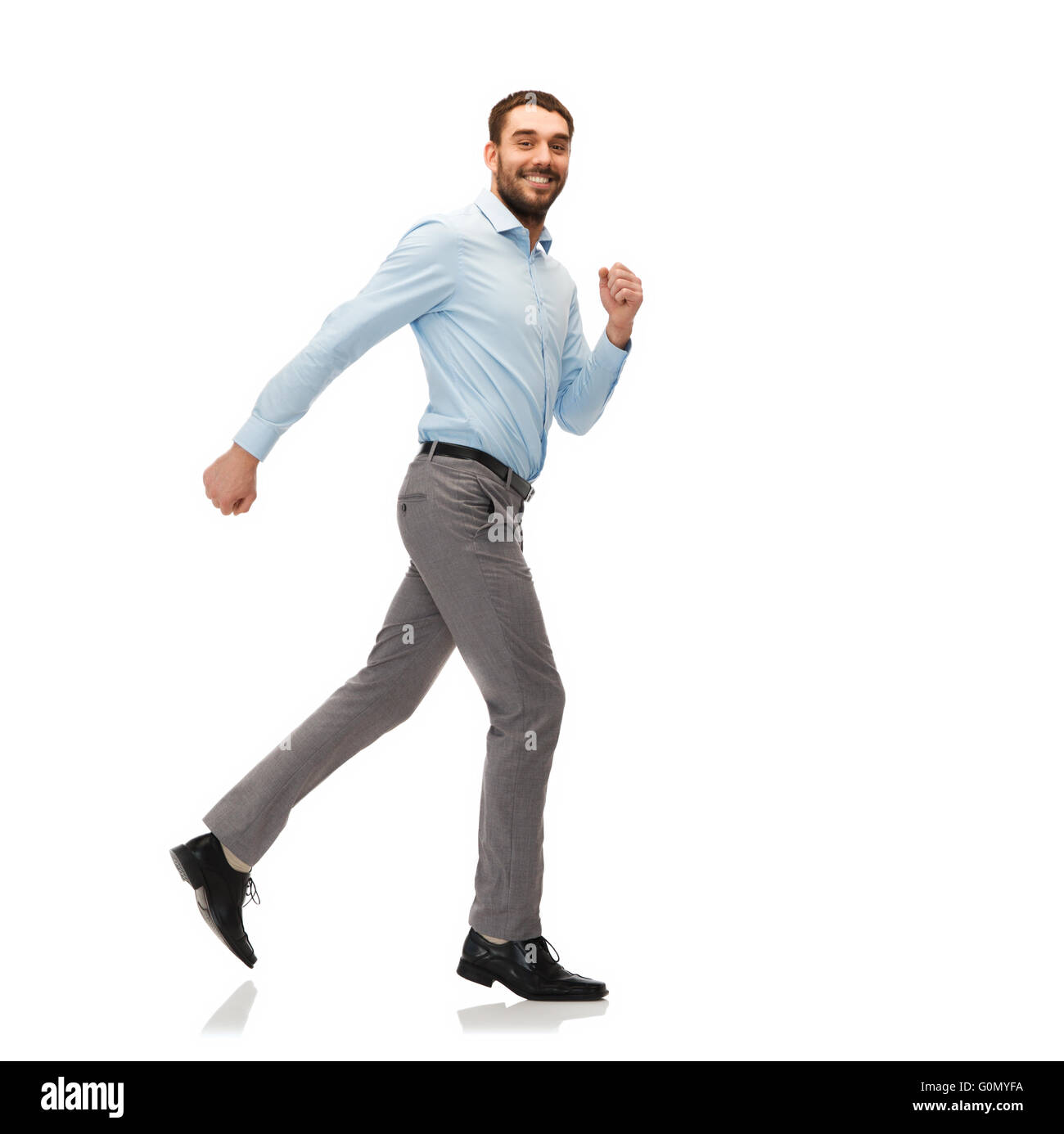 smiling young man running away Stock Photo
