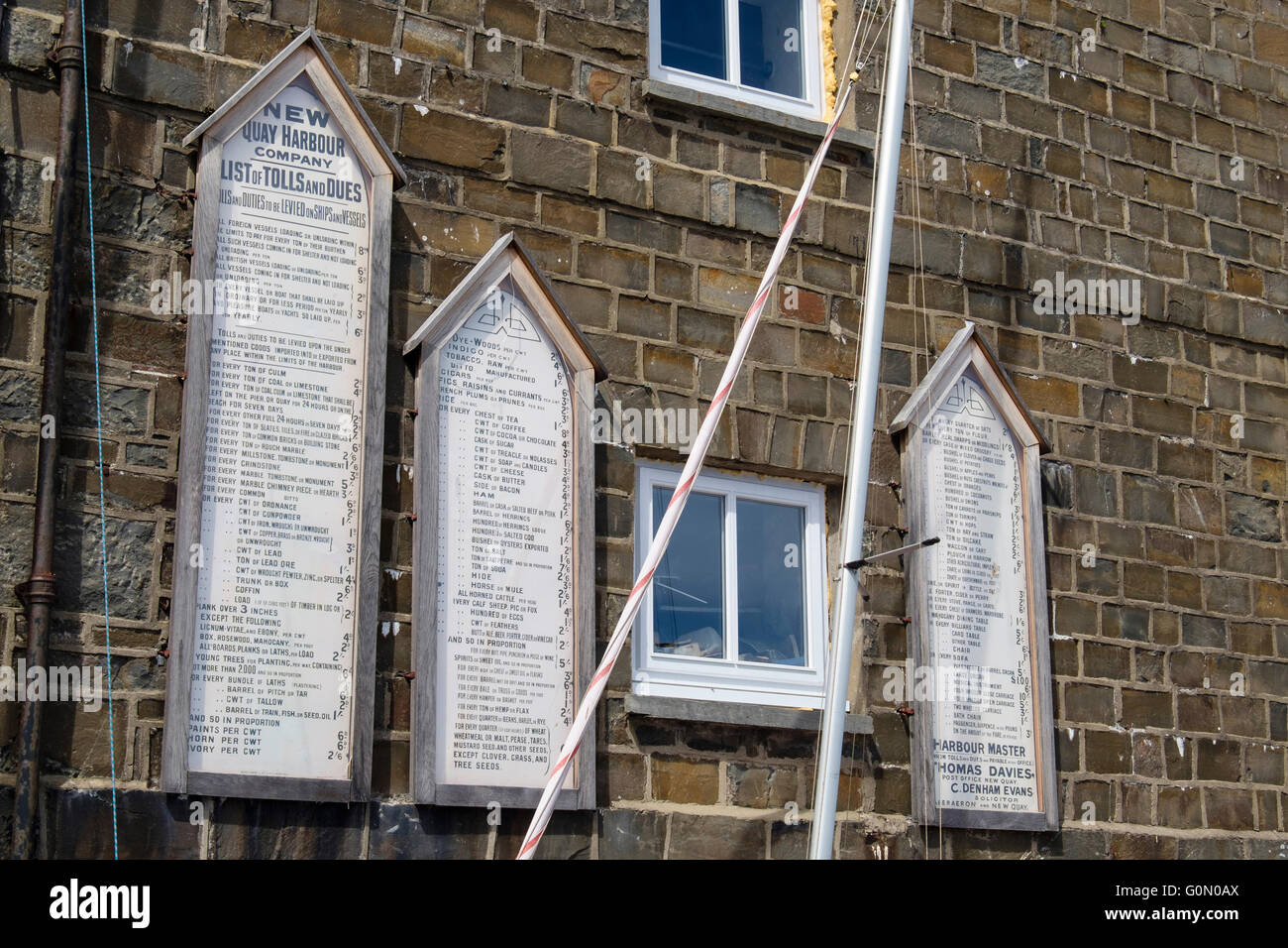Old Harbour Company historic list of Tolls and Dues for imports and exports levied on ships in New Quay, Ceredigion, - Stock Image