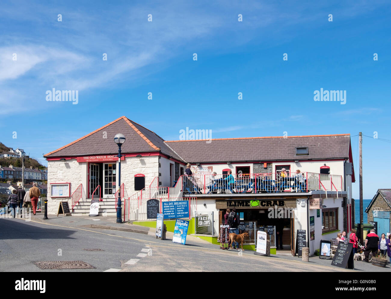 The Old Watch House cafe and restaurant with Fish and Chip shop below in fishing village popular with tourists. - Stock Image