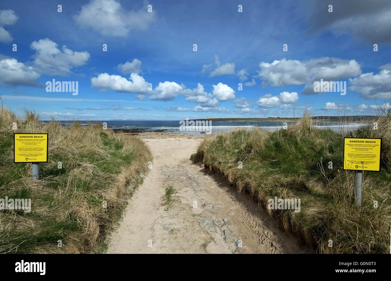 20/04/2016, Sign's warning of radioactive contamination in the form of metallic particles at Sandside beach, - Stock Image