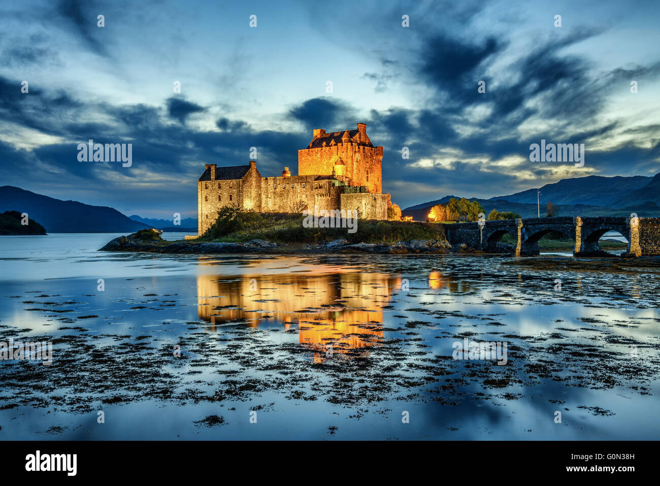 Eilean Donan Castle during blue hour after sunset. - Stock Image