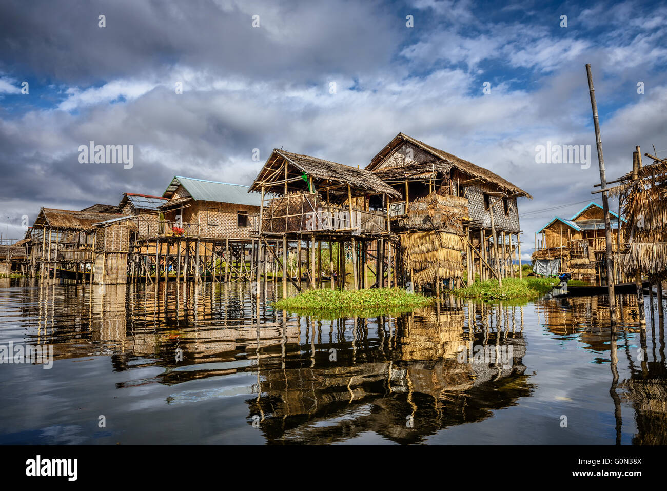 Wooden houses on piles inhabited by the tribe of Inthar, Inle Lake, Myanmar - Stock Image