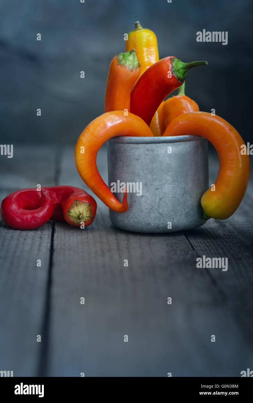 Chili pepper in a Cup on the table Stock Photo