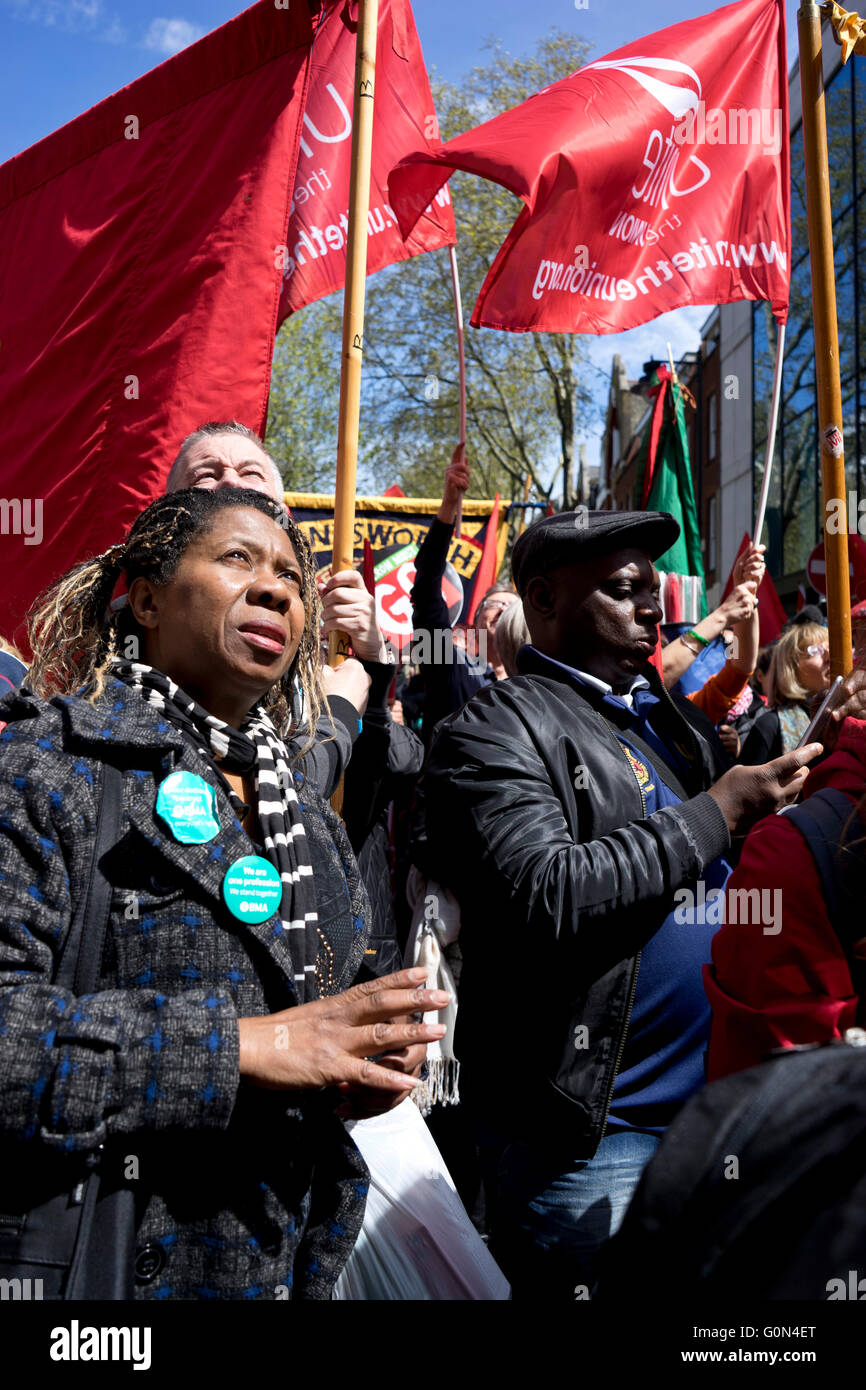 London,UK.1st May 2016. Demonstrators display banners and badges during International Workers May Day rally. Stock Photo