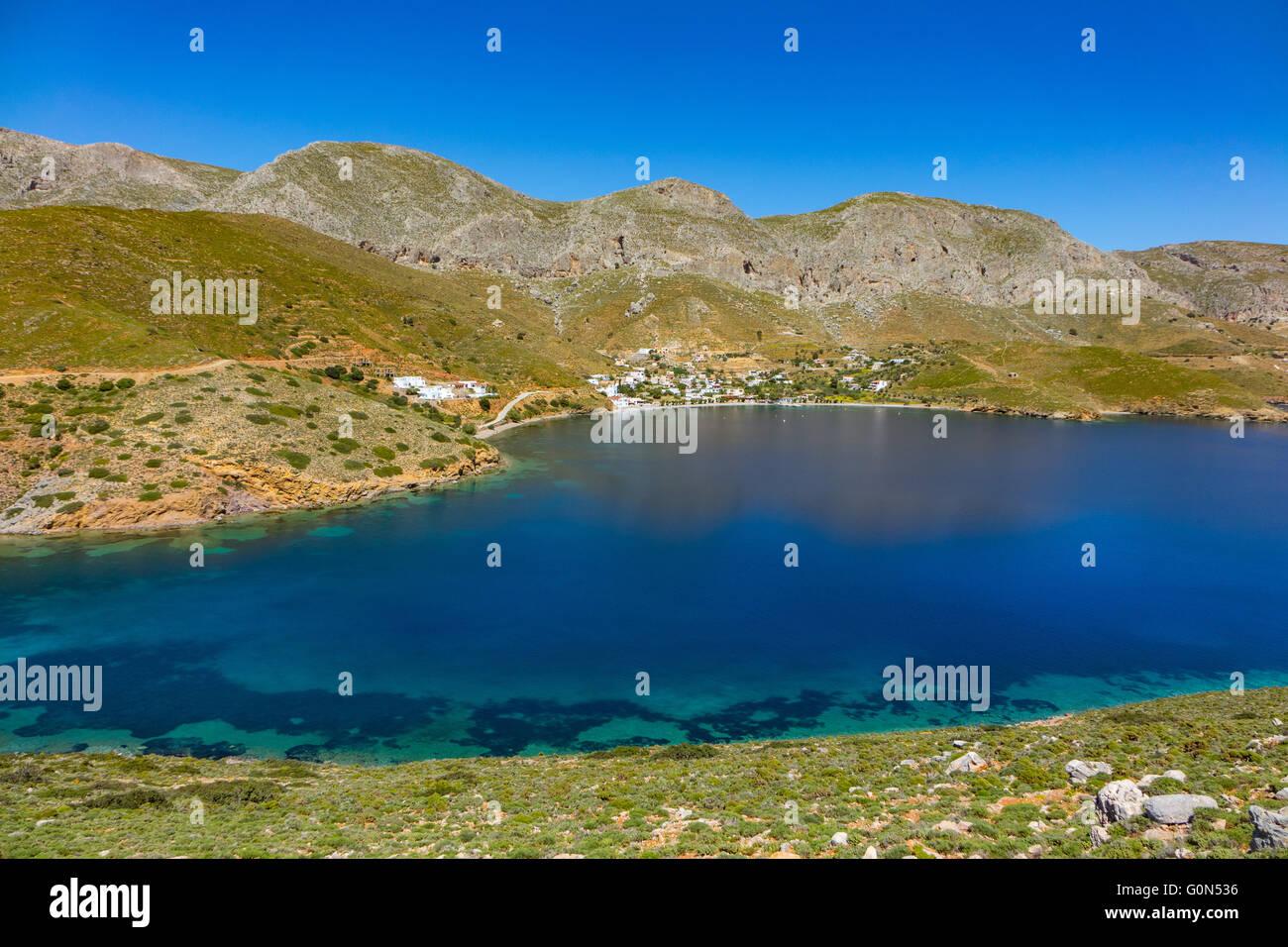 Blue sea and mountains at Emborios Bay Kalymnos, Greece - Stock Image