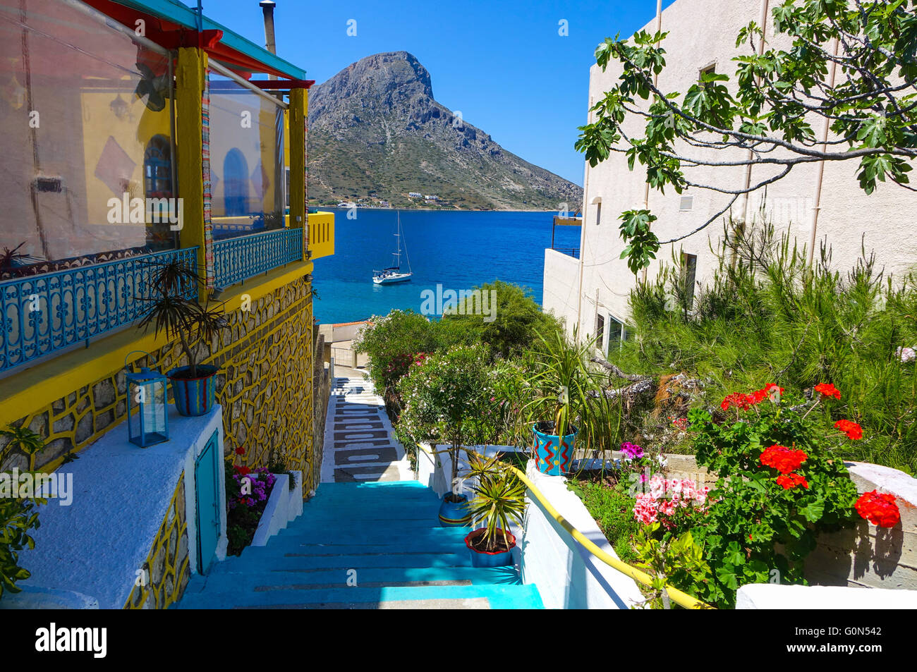 massouri holiday resort kalymnos greece with blue steps moored