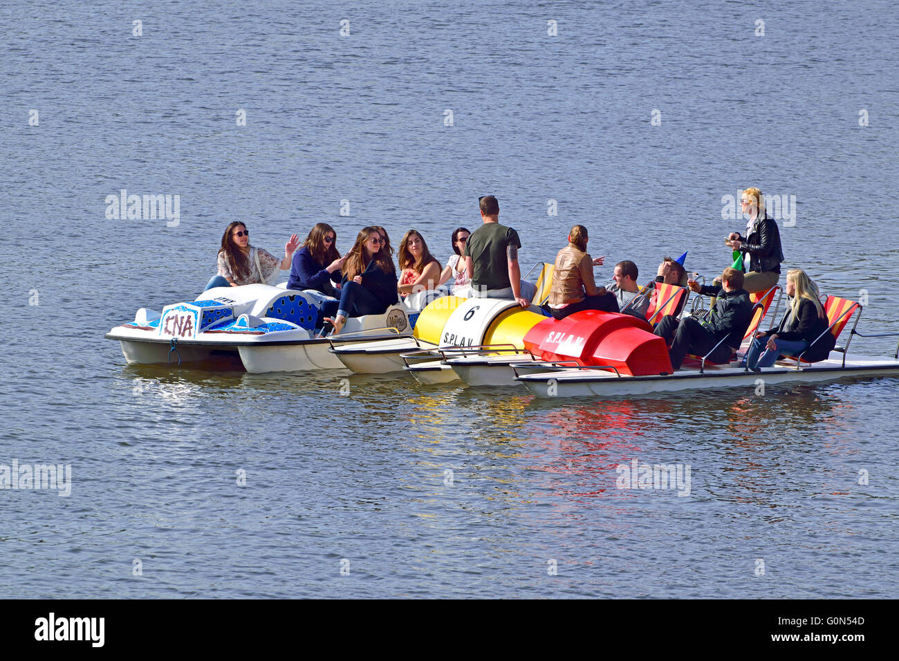 Prague, Czech Republic. Paddle boats for hire on the River Vltava - boys' boats meeting girls' boats - Stock Image