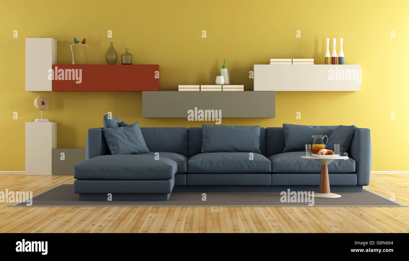 Modern living room with blue sofa and colorful wall unit on yellow ...