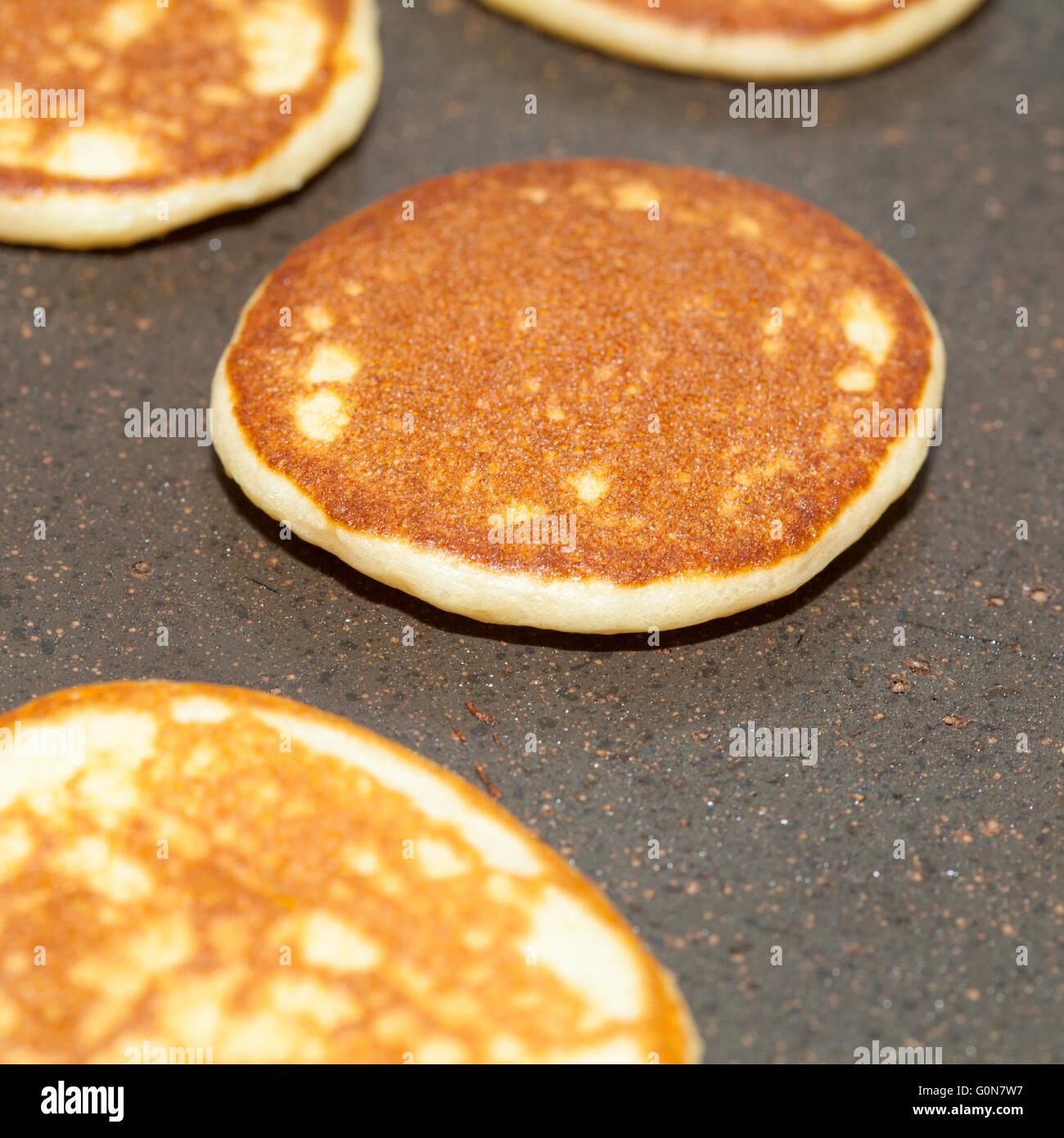 making thick potato cakes with yogurt - Stock Image