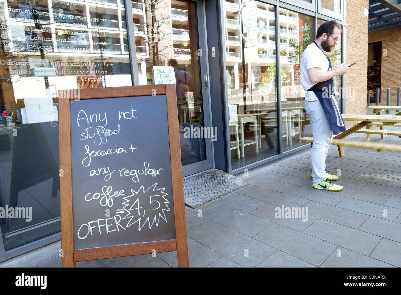 Gentrification in Dalston, East London - trendy new cafe in Dalston Square - Stock Image