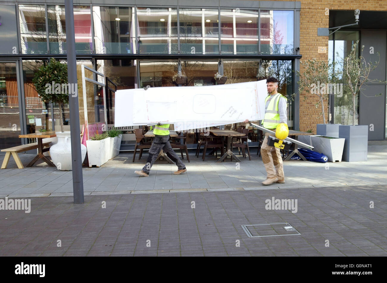 Gentrification in Dalston, East London - builders are a common sight - Stock Image