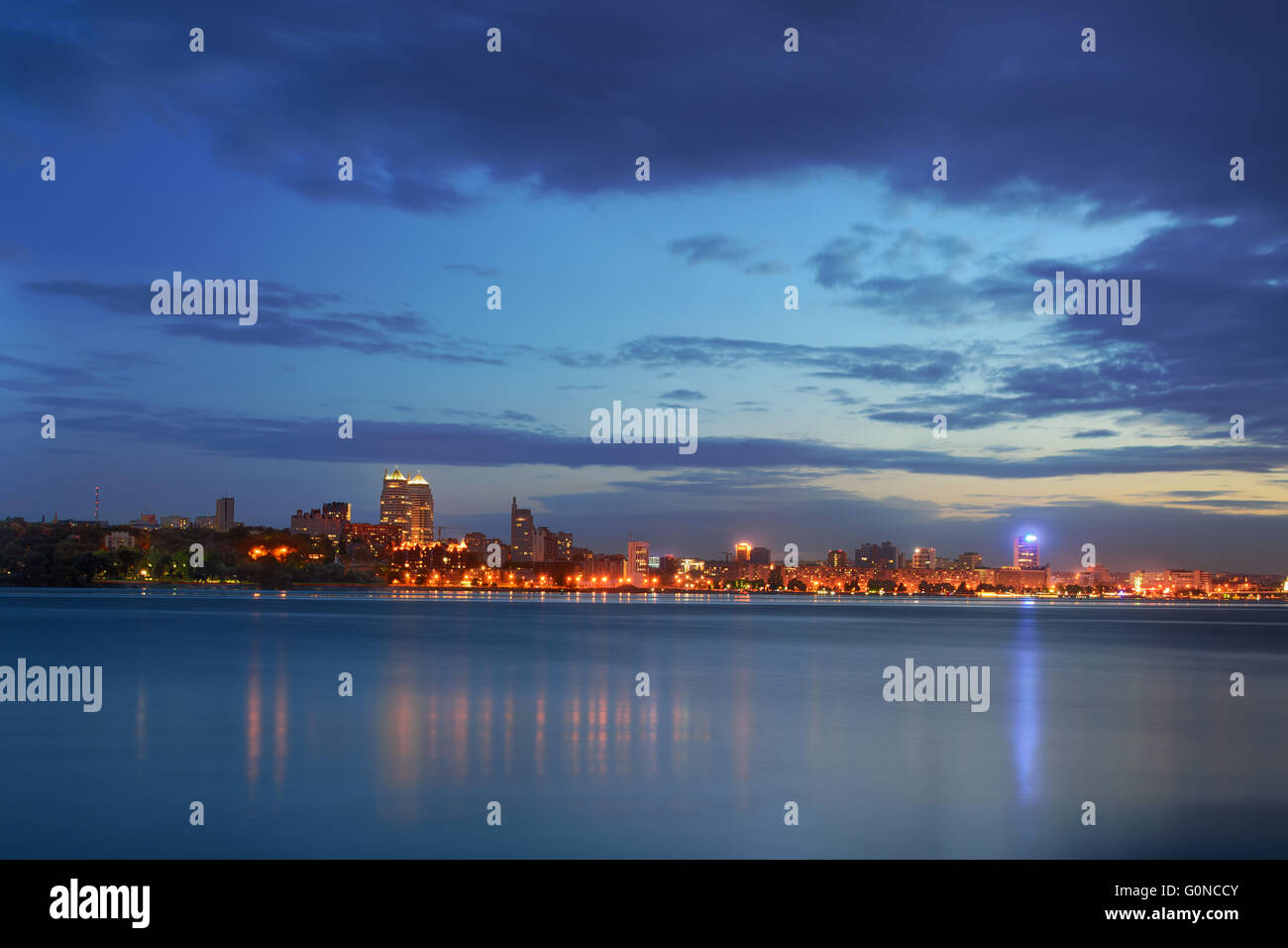 Vew of the waterfront at dusk Dnipropetrovsk. - Stock Image