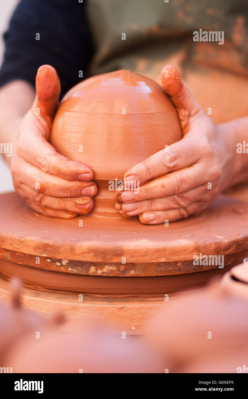 the potter's hands shaping clay on the lathe, Valencia. - Stock Image