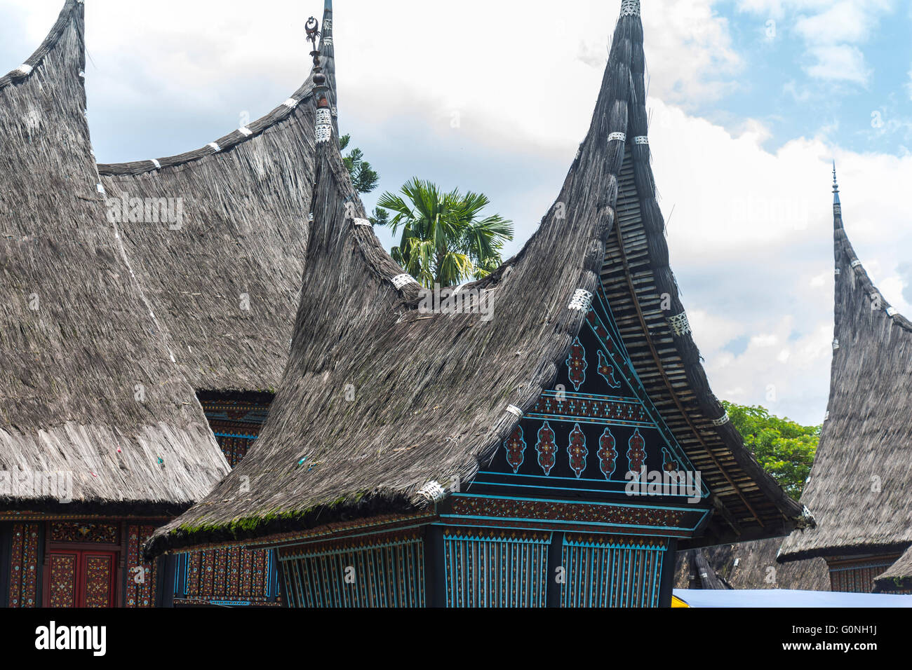 Traditional indonesian houses in Taman Mini Park - Stock Image