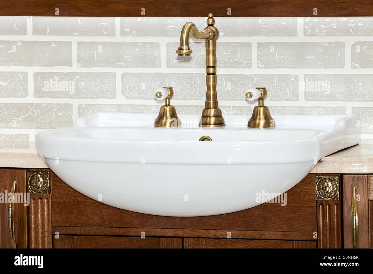 Gold faucet in bathroom Stock Photo: 103736715 - Alamy