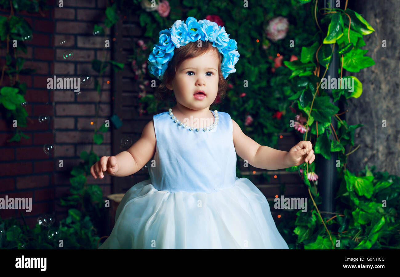 beautiful baby wearing a flower crown in the studio Stock Photo ...