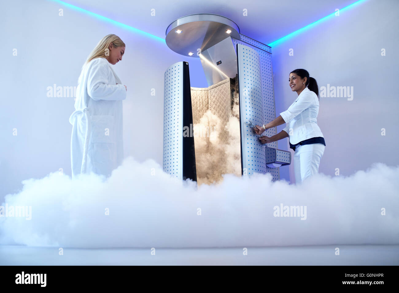 Portrait of woman going for cryotherapy treatment in cryosauna booth. - Stock Image