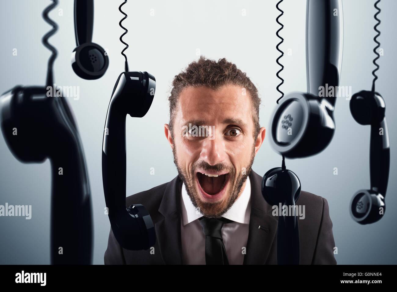 Stressful phone calls - Stock Image