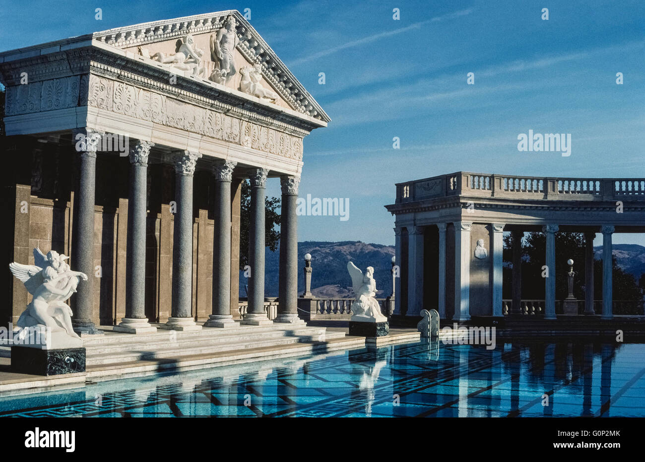 The facade of an ancient Roman temple is the centerpiece of a vast outdoor swimming pool at Hearst Castle, the regal - Stock Image