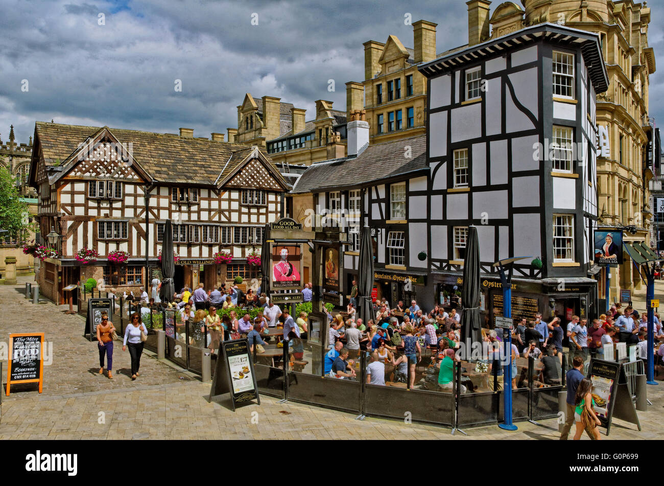 The Old Wellington Inn and Sinclairs Oyster Bar, popularly known as 'The Shambles' in Exchange Square Manchester, - Stock Image