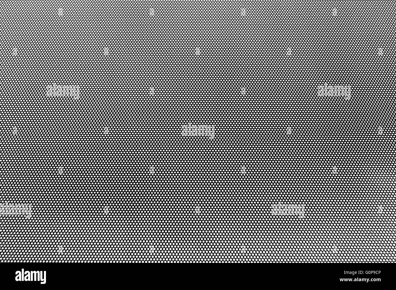 dot mask in front of greyish overcast sky psychedelic effect - Stock Image