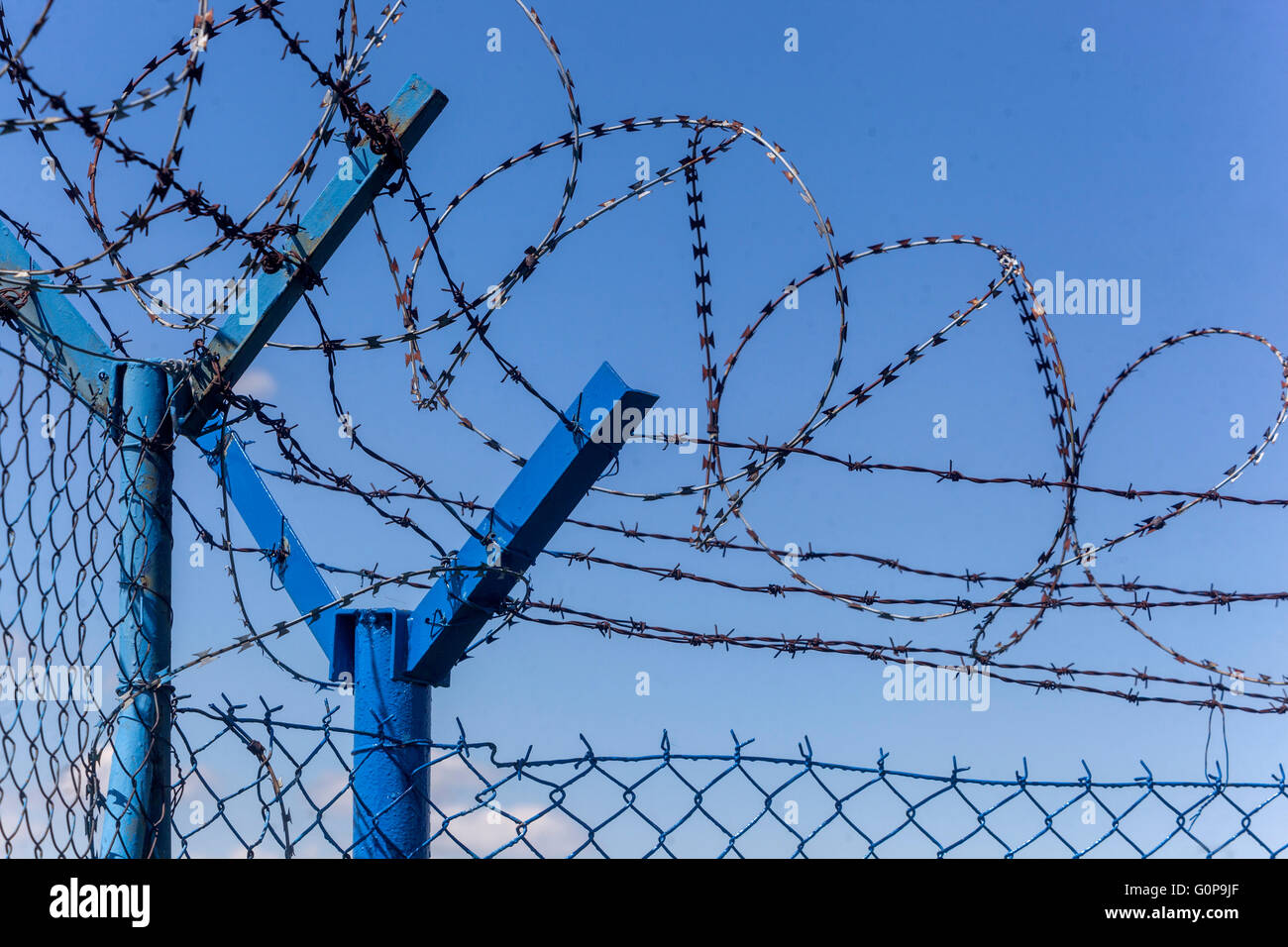 Razor wire and fence - Stock Image