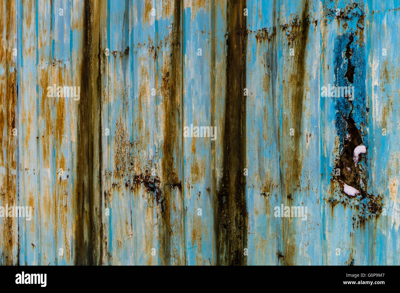Old rusty bluish iron wall background with ice. Perspective, therefore 3-dimensional effect surface texture - Stock Image