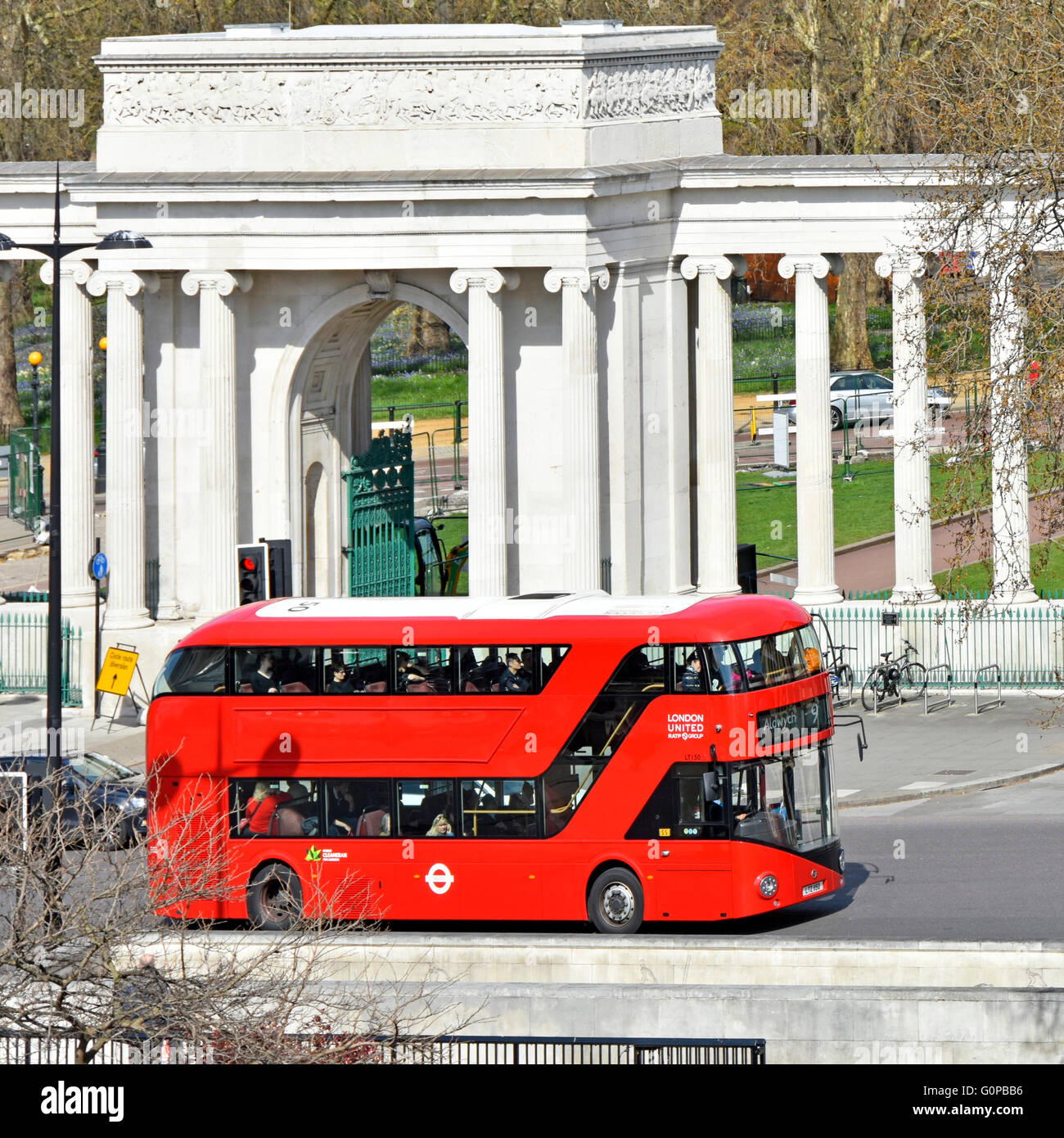 New London routemaster red bus without adverts on route nine passing Hyde Park corner screen at Hyde Park Corner - Stock Image