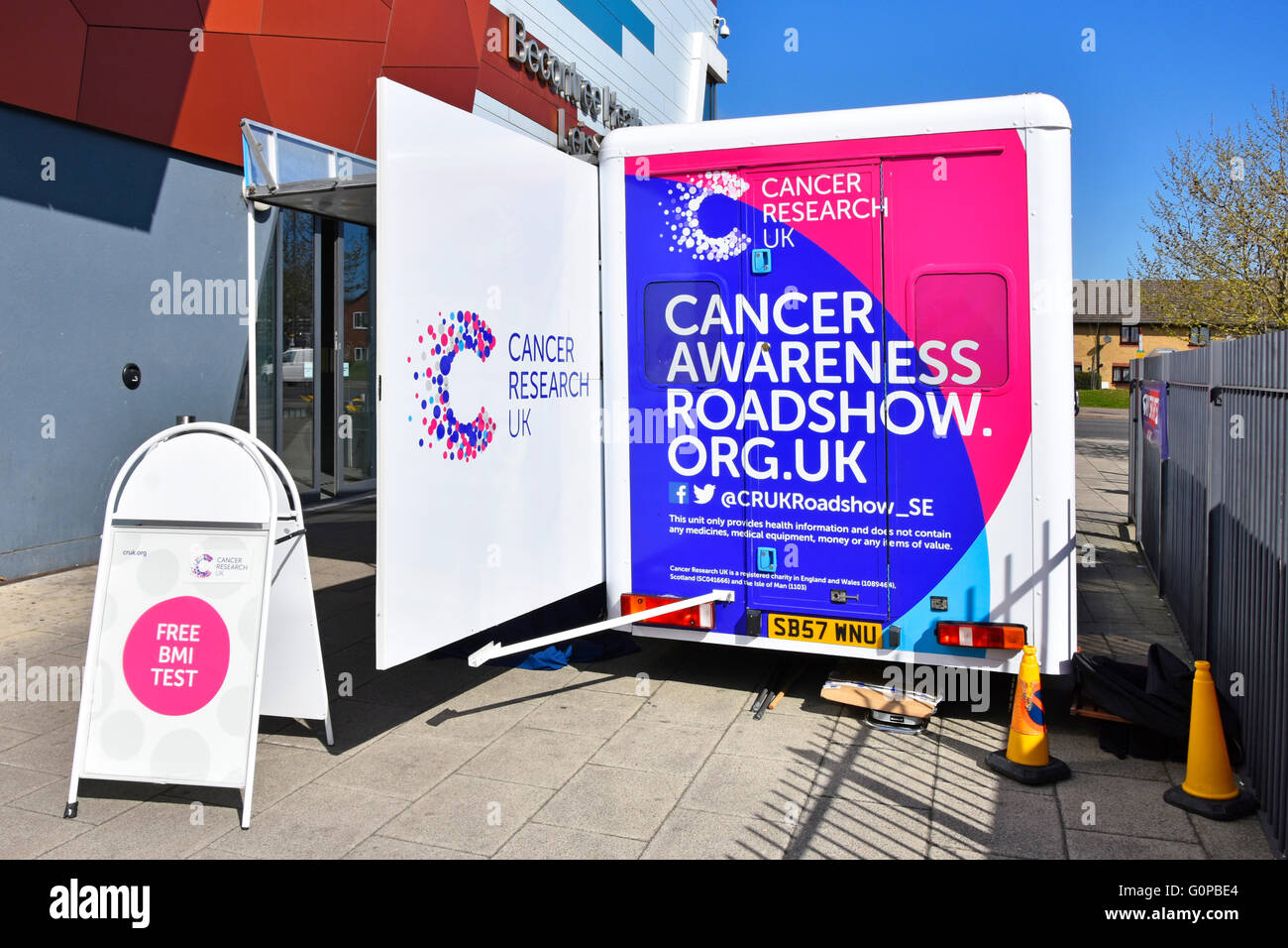 Cancer research uk awareness roadshow trailer parked outside Becontree Heath Leisure Centre in East London Borough - Stock Image