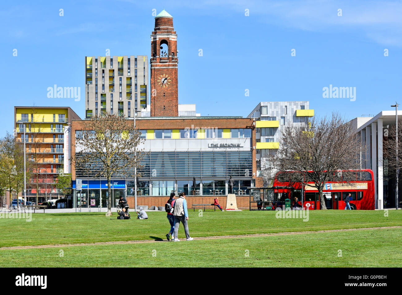 Part of Barking town centre from adjacent open space with clock tower, Broadway Theatre & modern flats London - Stock Image