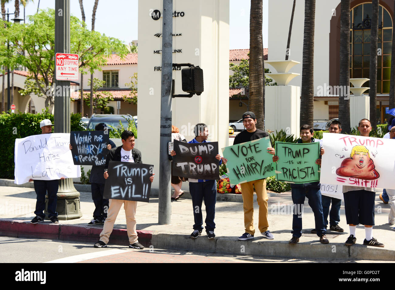 Hispanic anti-Trump demonstrators wave signs at traffic on street  in downtown Los Angeles Southern California USA - Stock Image