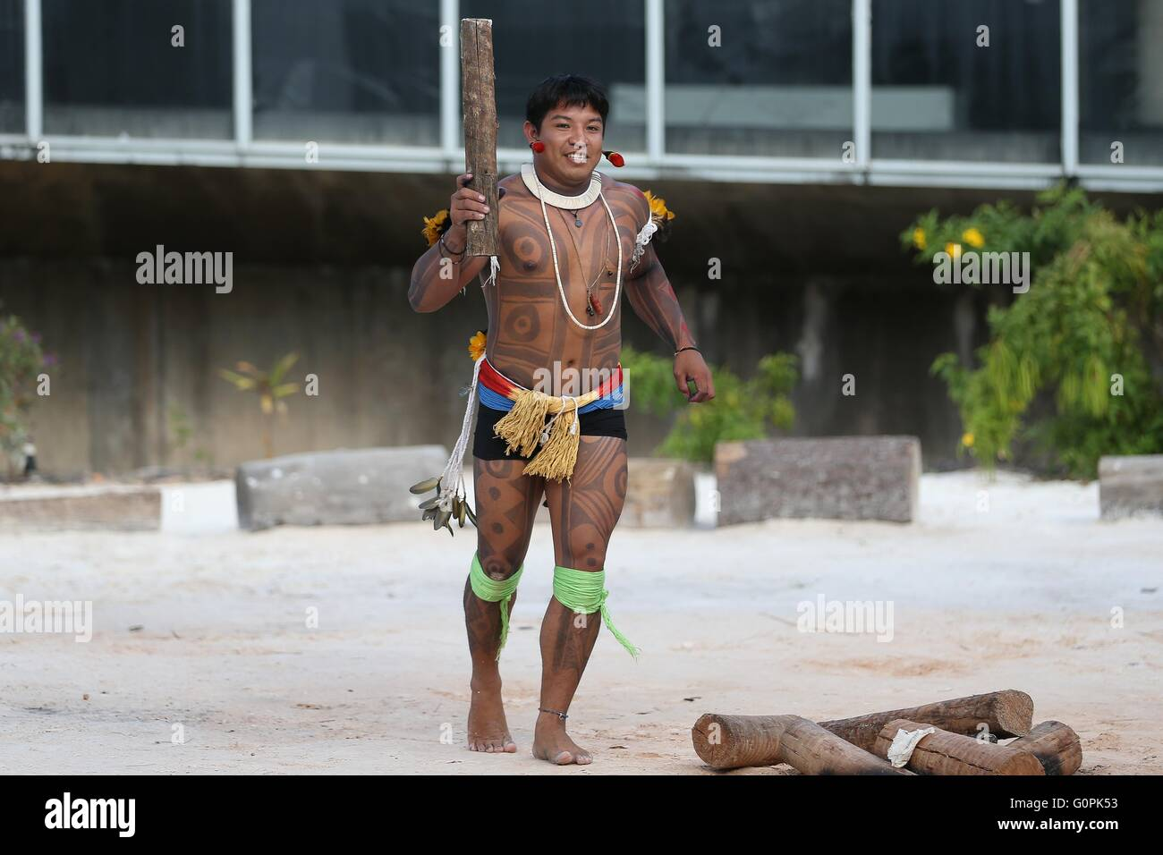 Brazilian indigenous torch carriers prepare for their turn as the Olympic flame relay kicks off May 3, 2016 in Brasilia, - Stock Image