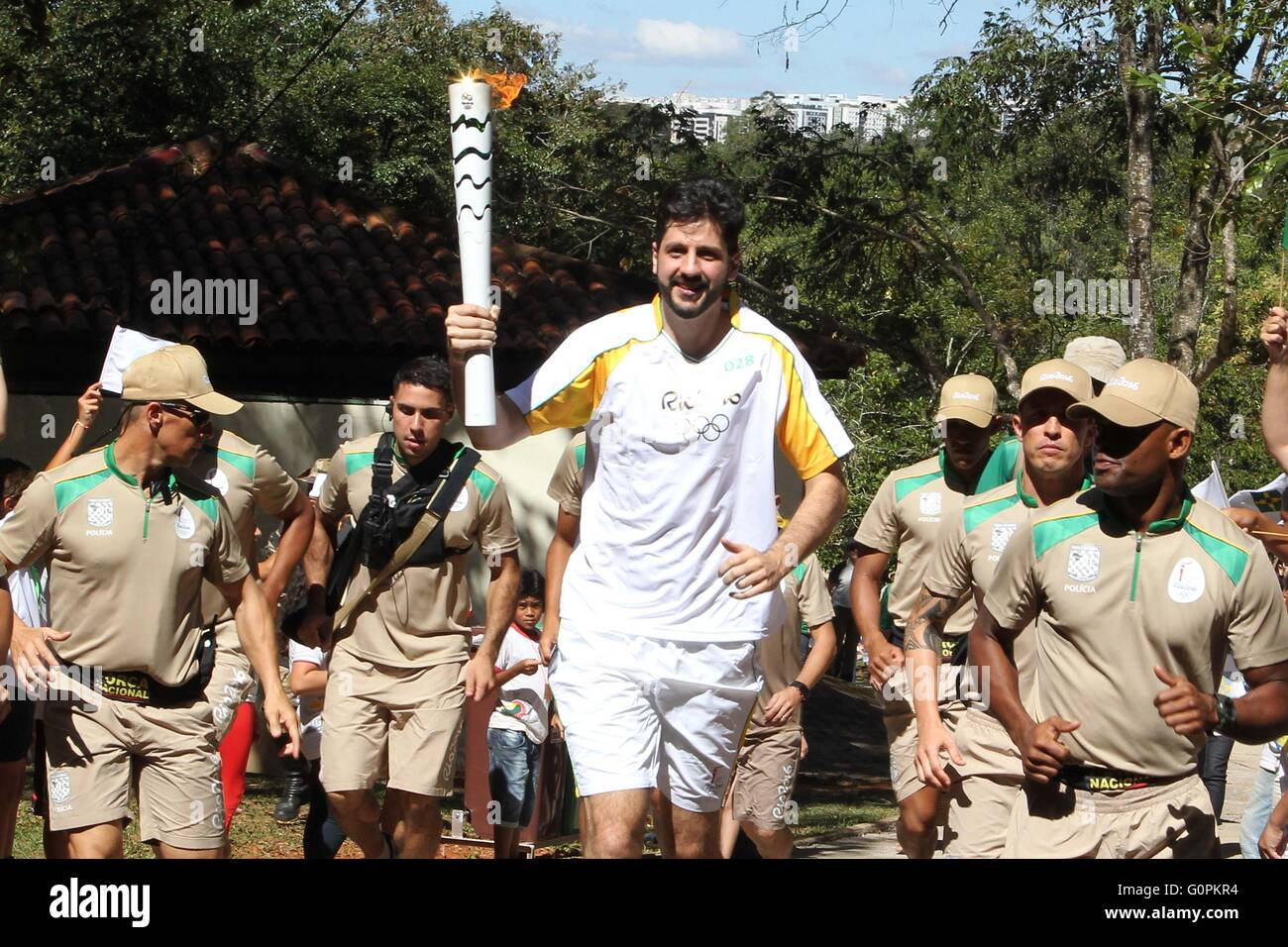 Brazilian basketball star Guilherme Giovannoni carries the Olympic torch at the Brasilia National Park as the Olympic - Stock Image