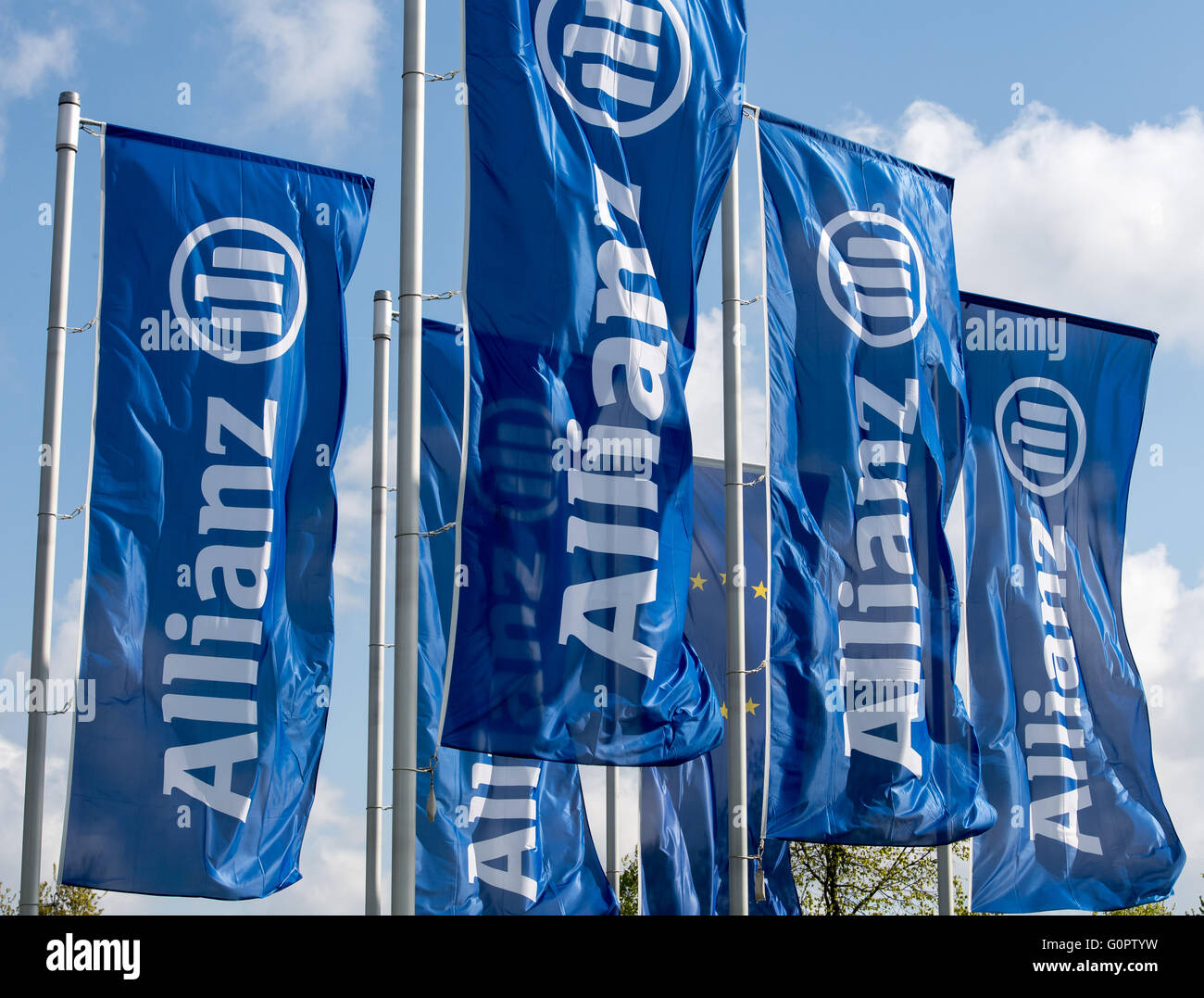 Munich, Germany. 04th Apr, 2016. Blue flags written with 'Allianz' wave ahead of the Allianz general assembly in Munich, Germany, 04 April 2016. Photo: PETER KNEFFEL/dpa/Alamy Live News Stock Photo