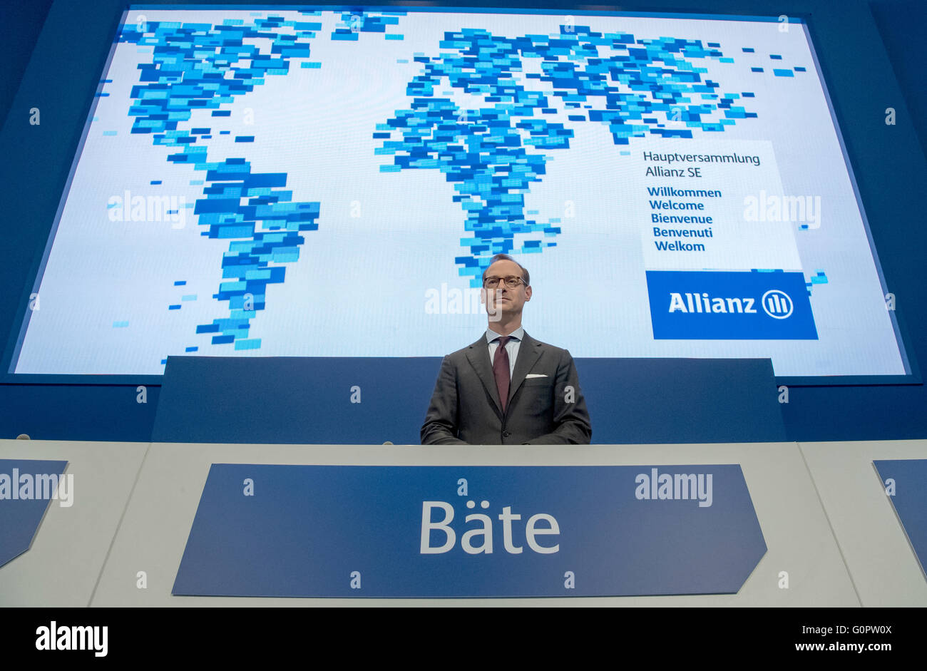 Munich, Germany. 04th Apr, 2016. CEO of Allianz SE, Oliver Baete, stands at the podium ahead of the Allianz general assembly in Munich, Germany, 04 April 2016. Photo: PETER KNEFFEL/dpa/Alamy Live News Stock Photo