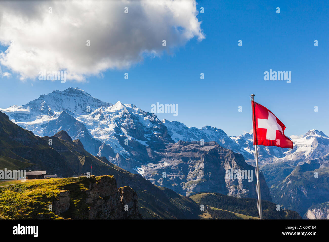 Stunning view of the Jungfrau and mountain range of Bernese alps from Mannlichen cablecar station, Switzerland. Stock Photo