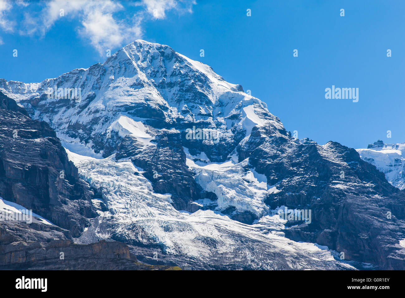 Close view of the famous peak Monch of the swiss Alps on Bernese Oberland in Switzerland. It is one of the main - Stock Image
