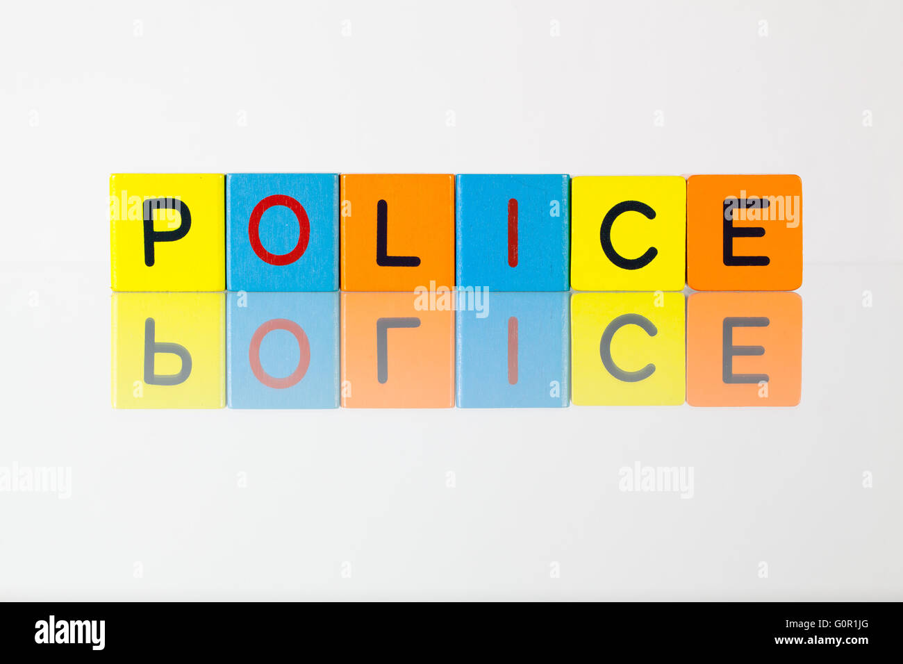 Police - an inscription from children's wooden blocks - Stock Image